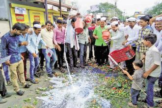 A file photo of farmers spilling out milk on a road during their state-wide protest at Parbhani in Maharashtra in April 2017. Photo: PTI