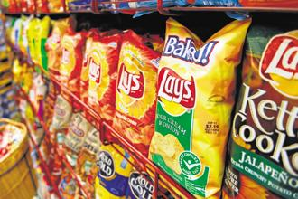 PepsiCo India has cut salt content by 13% in Lay's India's Magic Masala variant and 15% in the Spanish Tomato Tango variant, the company said. Photo: Bloomberg