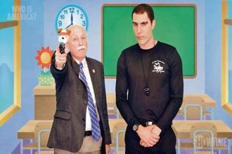 Sacha Baron Cohen (right) alongside gun rights advocate Philip Van Cleave, who is advocating the use of toys stuffed with guns in order to arm pre-schoolers.
