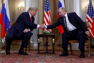 US President Donald Trump and his Russian counterpart Vladimir Putin shake hands as they meet in Helsinki, Finland on 16 July. Photo: Reuters
