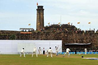 A file photo of Sri Lankan cricket team in front of the 17th century Dutch fort overlooking the pitch at Galle Stadium in Sri Lanka in July 2009. Photo: AFP