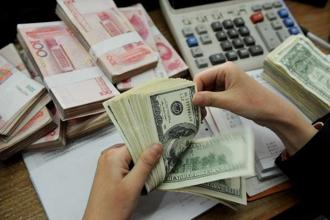 Yuan on Friday plunged past 6.80 per dollar for the first time in a year and China's central bank shows little sign of intervening to stem the slide. Photo: AFP