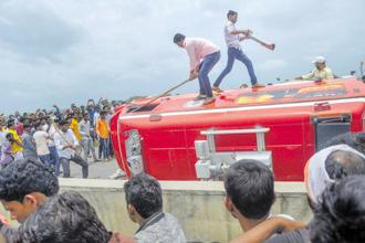 Protesters attack an ambulance after a clash with the police in Aurangabad on Tuesday. Marathas, who account for 32-35% of Maharashtra's population, are demanding 16% quota in education and government jobs.