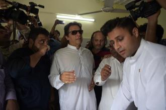 Imran Khan cast his vote in Bani Gala, Islamabad, telling the media it was 'time to defeat parties which kept this country hostage for years'. Photo: AFP