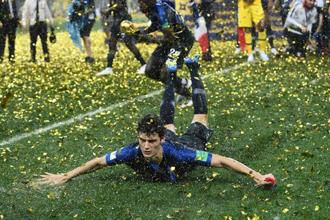 France's defender Benjamin Pavard celebrates their win during the trophy ceremony at the end of the Russia 2018 World Cup final football match between France and Croatia at the Luzhniki Stadium in Moscow. Photo: AFP