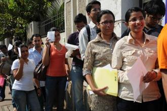 A file photo of CAT aspirants waiting outside an examination centre in Navi Mumbai. Photo: Mint