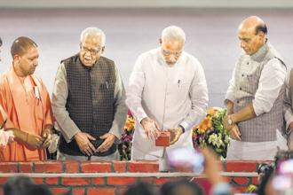 Prime Minister Narendra Modi with Uttar Pradesh chief minister Yogi Adityanath, governor Ram Naik and Union home minister Rajnath Singh at a foundation stone-laying ceremony in Lucknow on Sunday. Photo: PTI