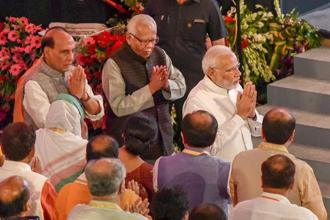 Prime Minister Narendra Modi with Union Home Minster Rajnath Singh and UP Governor Ram Naik in Lucknow. Photo: PTI