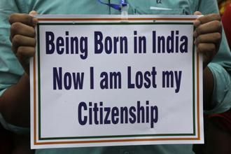An activist holds a placard during a rally in solidarity with those affected by the final draft of the National Register of Citizens (NRC) in Assam, in Kolkata. Photo: AP