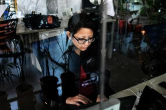 Only over a third of India's current 390 million users transact online, , suggesting massive untapped opportunity for e-commerce in India. Photo: Bloomberg