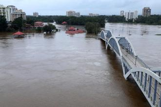 The Kerala government has sounded a red alert in 14 districts of the state and opened 35 dams, leading to floods in most regions of the state, including Aluva (above). Photo: PTI