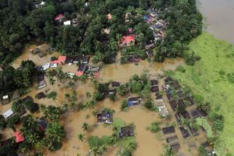 An aerial view shows partially submerged houses at a flooded area in the southern state of Kerala, 17 August. Photo: Reuters