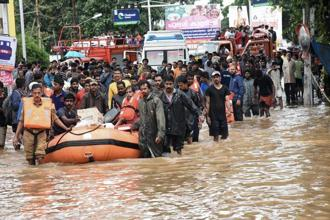 Rescue operations being carried out at flood-affected regions, in Kochi on Saturday. Photo: PTI