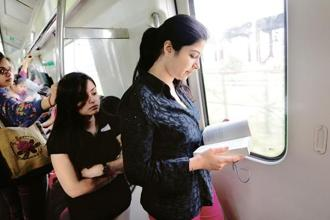 Try engaging in relaxing activities like reading a book during long commutes. Photo: Priyanka Parashar/Mint