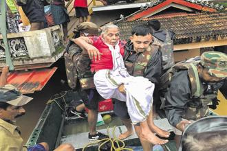Indian Army personnel rescue flood-affected people in Ernakulam district of Kerala on Tuesday. Photo: PTI.