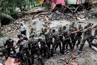 Army personnel carrying out flood rescue operations in Wayanad, one of Kerala's coffee producing districts. Photo: PTI