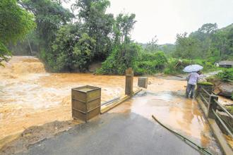 A file photo of floods after heavy rains in Kodagu, Karnataka. The state government is yet to survey the extent of damage to plantations and agricultural fields. Photo: PTI