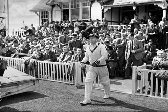 Sir Don Bradman walks in to bat. Photo: Fox Photos/Getty Images