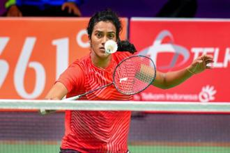 P.V. Sindhu in action against Vu Thi Trang of Vietnam in the women's singles badminton match at 18th Asian Games 2018 in Jakarta 23 August 2018. Photo: PTI