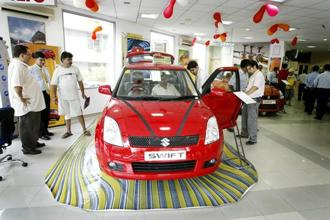 A used 2016 Maruti Suzuki Swift will set you back by ₹ 4.4 lakh in Delhi. Photo: Bloomberg
