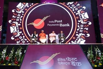 Prime Minister Narendra Modi with others at the launch of India Post Payments Bank (IPPB) in New Delhi on Saturday.