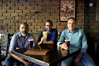 (From left) George, Venkatraju and Tolani and  are partners at Toit brewpub, Bengaluru.Jithendra M./Mint