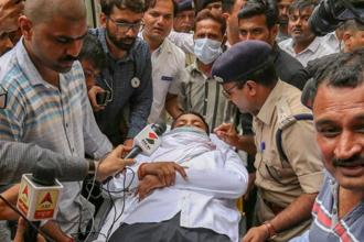 Doctors and police personnel monitor PAAS leader Hardik Patel's health as he is being taken to a hospital in Ahmedabad on 7 September, 2018.