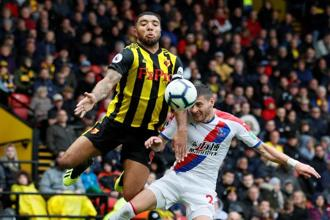 Watford's Troy Deeney (left) in action against Crystal Palace's Joel Ward on 26 August. Watford has a 100% record so far this season. Photo: Reuters