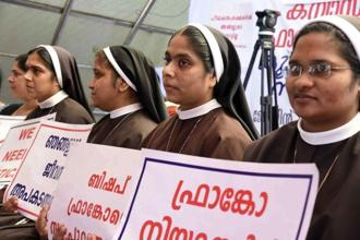 Catholic nuns hold placards demanding the arrest of a bishop who one nun has accused of rape, during a public protest in Kochi, Kerala, on Wednesday. Photo: AP