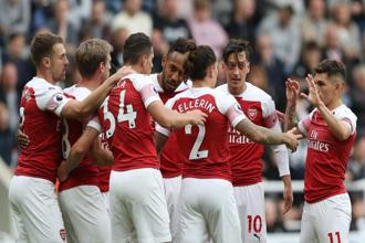 Arsenal players celebrate a goal against Newcastle United on Saturday. Photo: Reuters