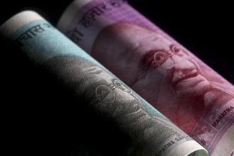 The rupee hit an all-time low of 72.9750 per dollar this week. Photo: Bloomberg