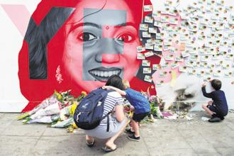 Floral tributes at a mural to Savita Halappanavar, a 31-year-old Indian dentist, who died in 2012 due to the complications of a septic miscarriage at 17 weeks' gestation, in Ireland. Photo: AFP
