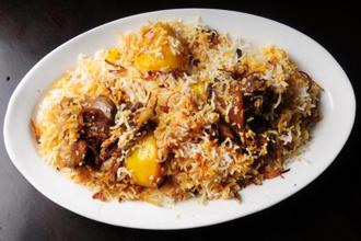 A plate of typical Kolkata biryani with meat, potato and egg. Photo: Indranil Bhoumik