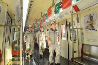 Chinese staff of Lahore Orange Line MetroTrain walk during the unveiling ceremony of the first set of carriages of Lahore Orange Line MetroTrain in Lahore on October 8, 2017. Photo: AFP