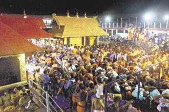 The Supreme Court court recently ruled in favour of allowing menstruating-age girls and women to enter the ancient temple of Sabarimala in Kerala. Photo: PTI