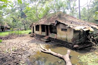 A traditional clay-tiled houses that got destroyed in the Kerala floods. Photos: Nidheesh M.K.