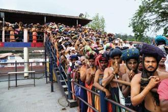 Devotees wait in queues inside the premises of the Sabarimala.
