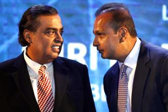 Reliance Industries chairman Mukesh Ambani with brother Reliance Group chairman Anil Ambani. Photo: Reuters