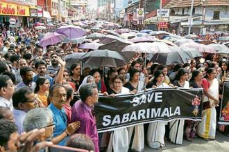A file photo of people protesting the Supreme Court verdict ending the practice of keeping women out of the Sabarimala temple. Photo: Reuters