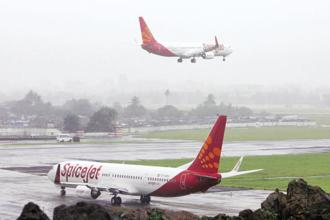 Crisil has downgraded its long-term rating on SpiceJet's bank facilities from BBB stable to BB negative. Photo: Reuters