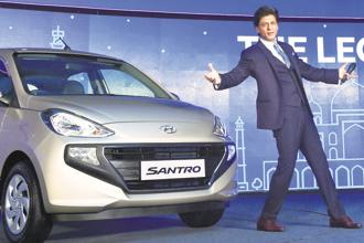 Bollywood actor Shah Rukh Khan at the launch of the new Santro in New Delhi on Tuesday. Hyundai generates about 20% of its total sales from rural and semi-urban areas while Maruti Suzuki garners 30-35% of its sales from such regions. Photo: PTI