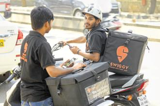 Swiggy is spending heavily to keep its lead over rivals such as Zomato and Uber Eats. Photo: Mint