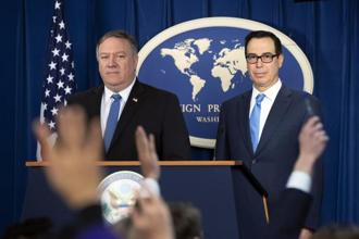 US secretary of state Mike Pompeo (left) and treasury secretary Steven Mnuchin, present details of the new Iran sanctions at the Foreign Press Center in Washington on Monday. Photo: AP