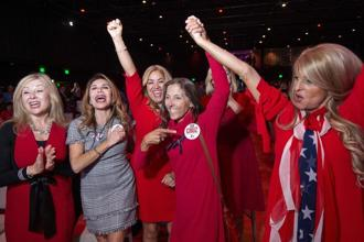 Members of the Trumpettes celebrate as incumbent Texas Senator Ted Cruz of the Republican Party is announced as the winner over his Democratic challenger Representative Beto O'Rourke in Dallas on Tuesday. Photo: AP