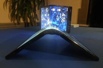 A FlexPai smartphone with a flexible screen displayed in San Francisco on 5 November. Samsung announced its plans for its own foldable phone in San Francisco on 7 November. Photo: AP