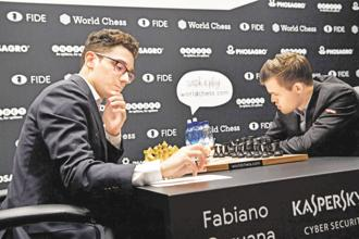 Fabiano Caruana (left) and Magnus Carlsen at the first game of the 2018 World Chess Championship in London. Photo: AFP