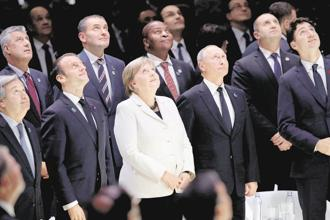 World leaders after the commemoration ceremony for Armistice Day in Paris. Photo: Reuters