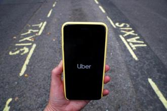 The new program, called Uber Rewards, aims to keep passengers in Uber's ecosystem. Photo: Reuters