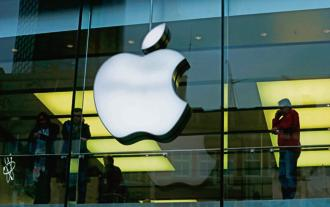 An Apple logo is seen on the building's facade. Photo: Reuters