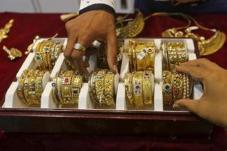 Gold prices today jumped above Rs 32,000 per 10 grams. Photo: Reuters